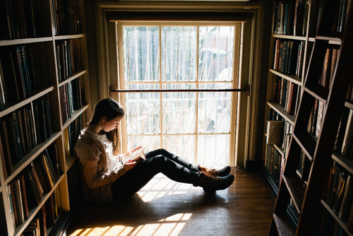 Young-Woman-Reading-Book.jpg