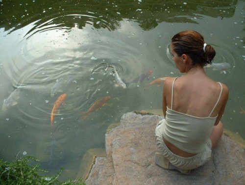 Girl and Koi Fish - Sandra V