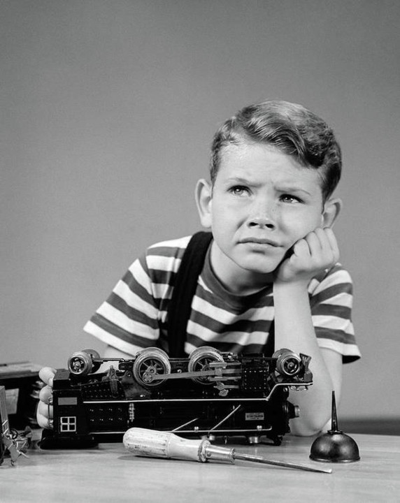 1930s-1940s-little-boy-thinking-or-vintage-images.